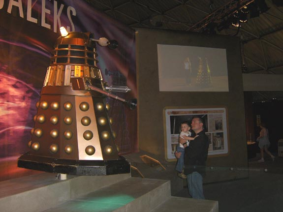 Daddy protects Thomas from a hovering Dalek