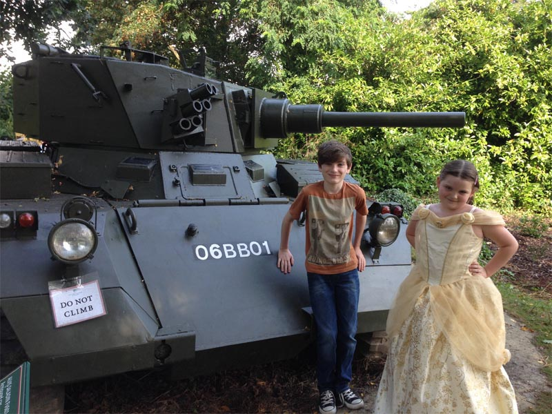 [Tom and Emma and a tank]