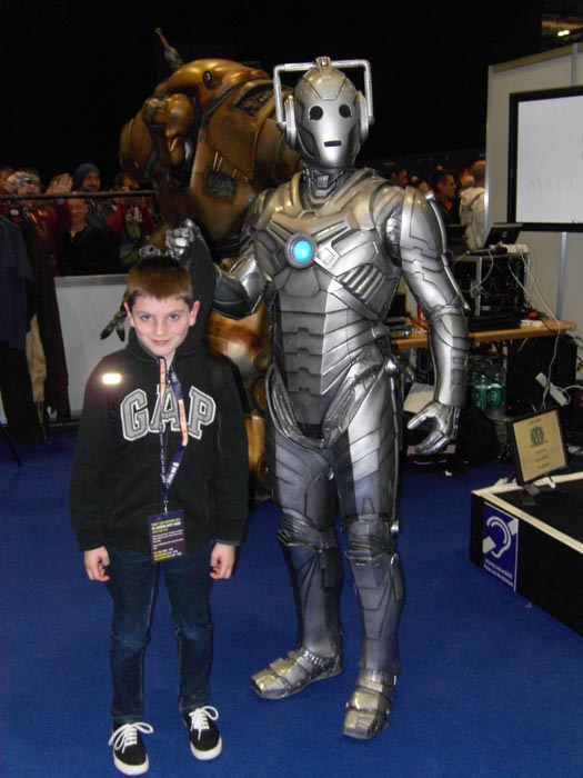 [Tom caught by a Cyberman]